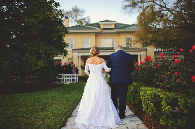 backyard wedding tampa: father and bride walking down aisle