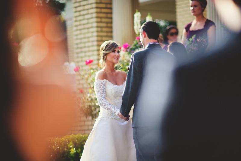 backyard wedding tampa: bride and groom saying vows