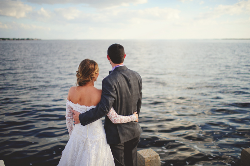 backyard wedding tampa: bride and groom looking out in tampabay