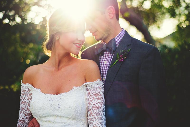 backyard wedding tampa: sunlit bride and groom