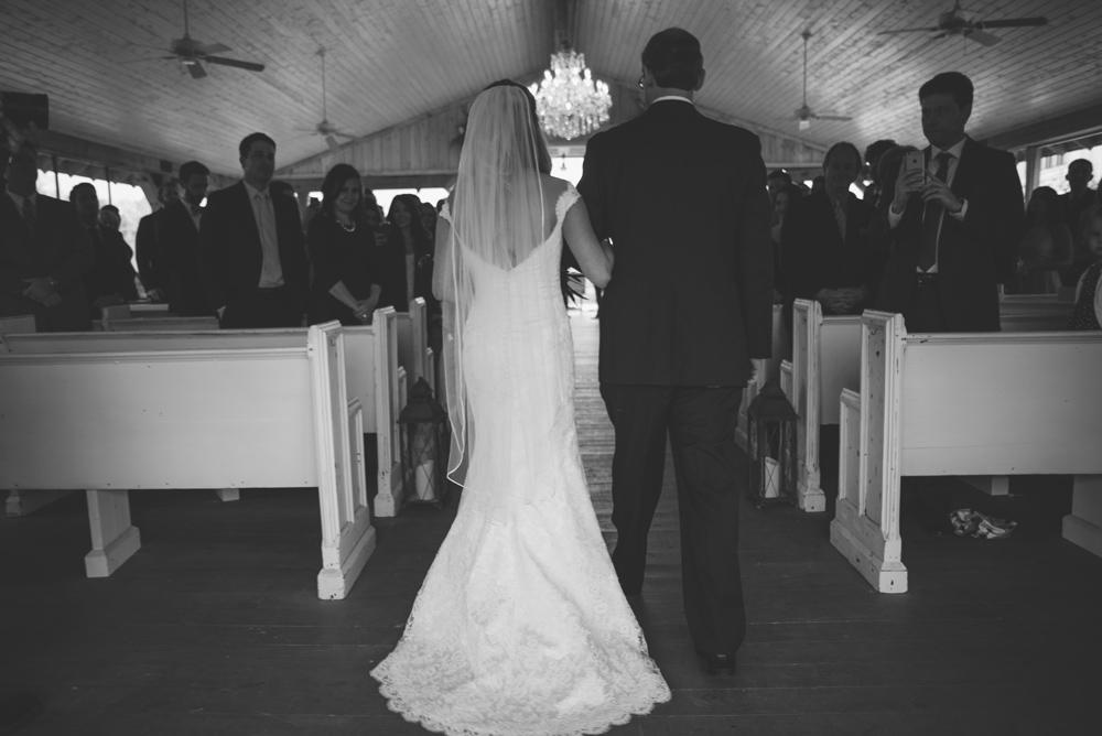 mint springs farm wedding: bride walking down aisle
