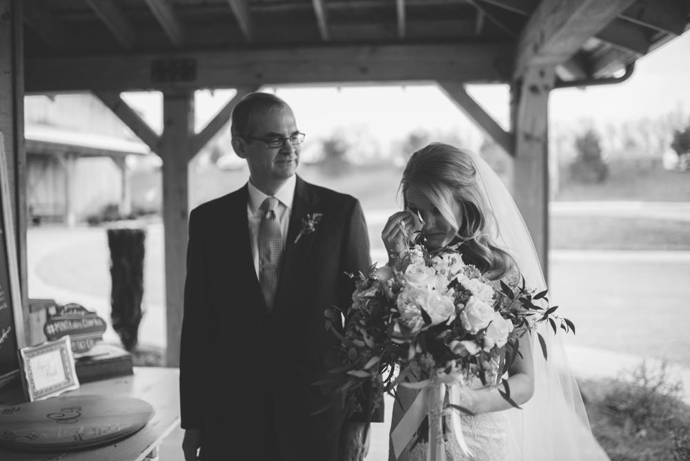bride crying before waling down aisle