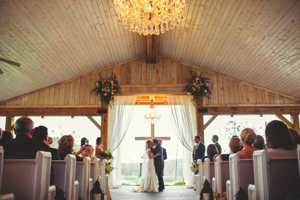 mint springs farm wedding: first kiss