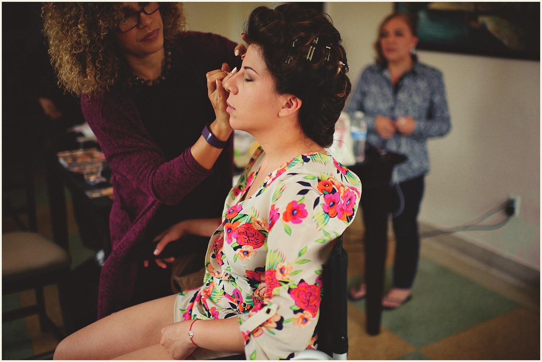 romantic vizcaya wedding : bride getting makeup done