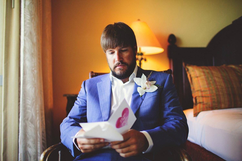 pierre's restaurant wedding: groom reading letter