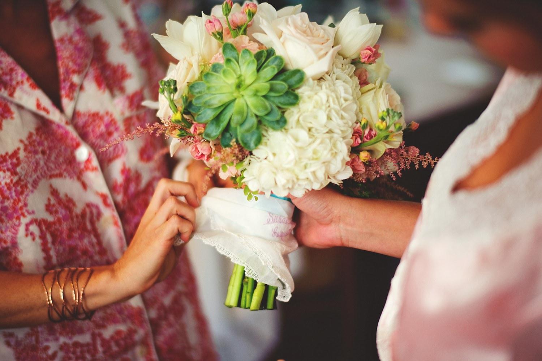 pierre's restaurant wedding: putting handkerchief on bouquet