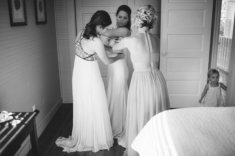 pierre's restaurant wedding: bride getting in dress