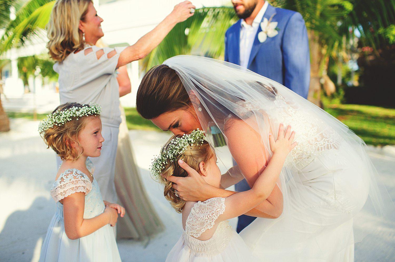 pierre's restaurant wedding: bride kissing flower girls