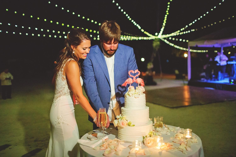 pierre's restaurant wedding: bride and groom cutting cake