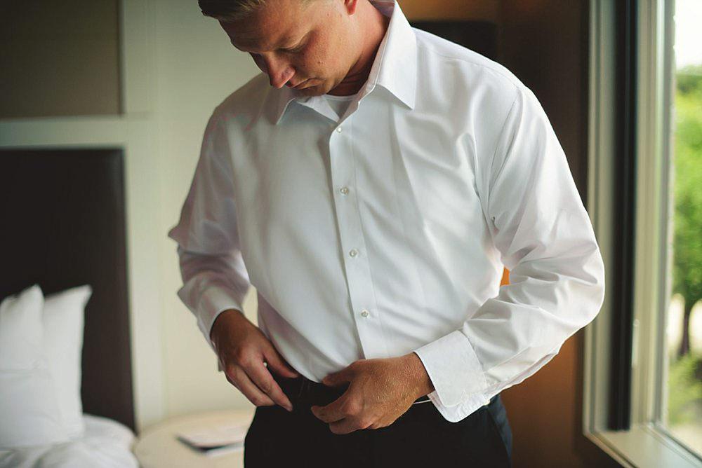 oxford exchange wedding : groom fixing belt