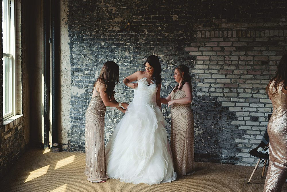 oxford exchange wedding : bride getting in dress