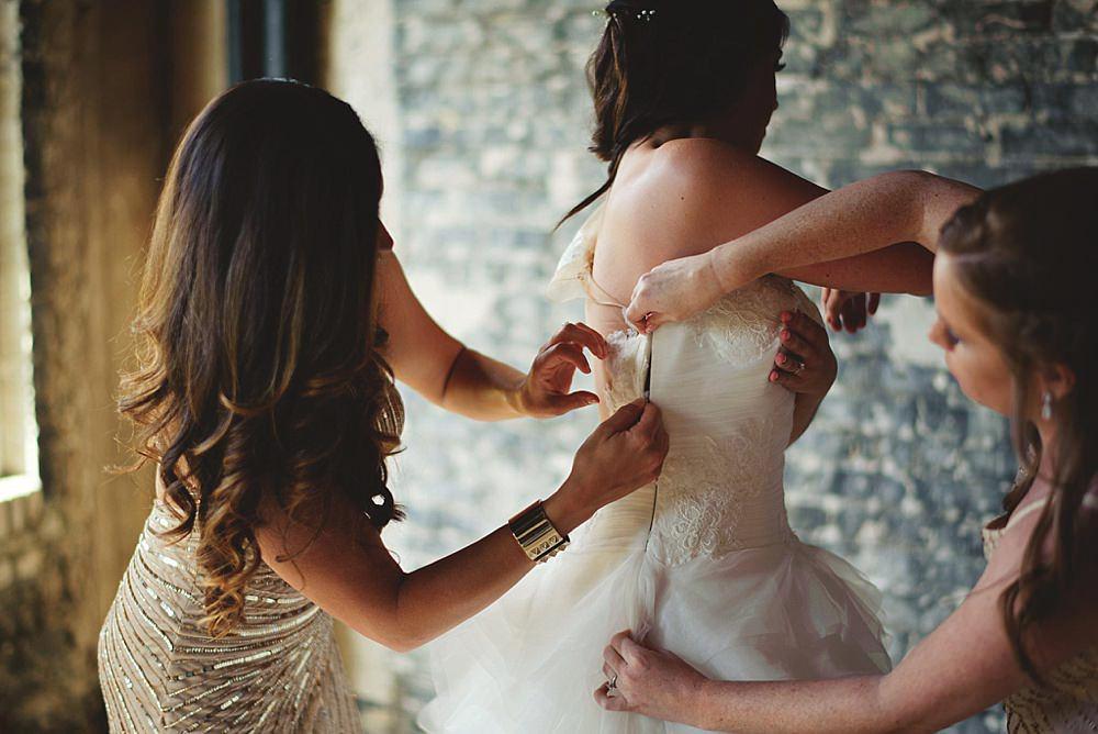oxford exchange wedding : bride zipping up dress