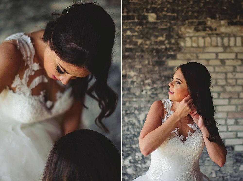 oxford exchange wedding : bride putting in earrings