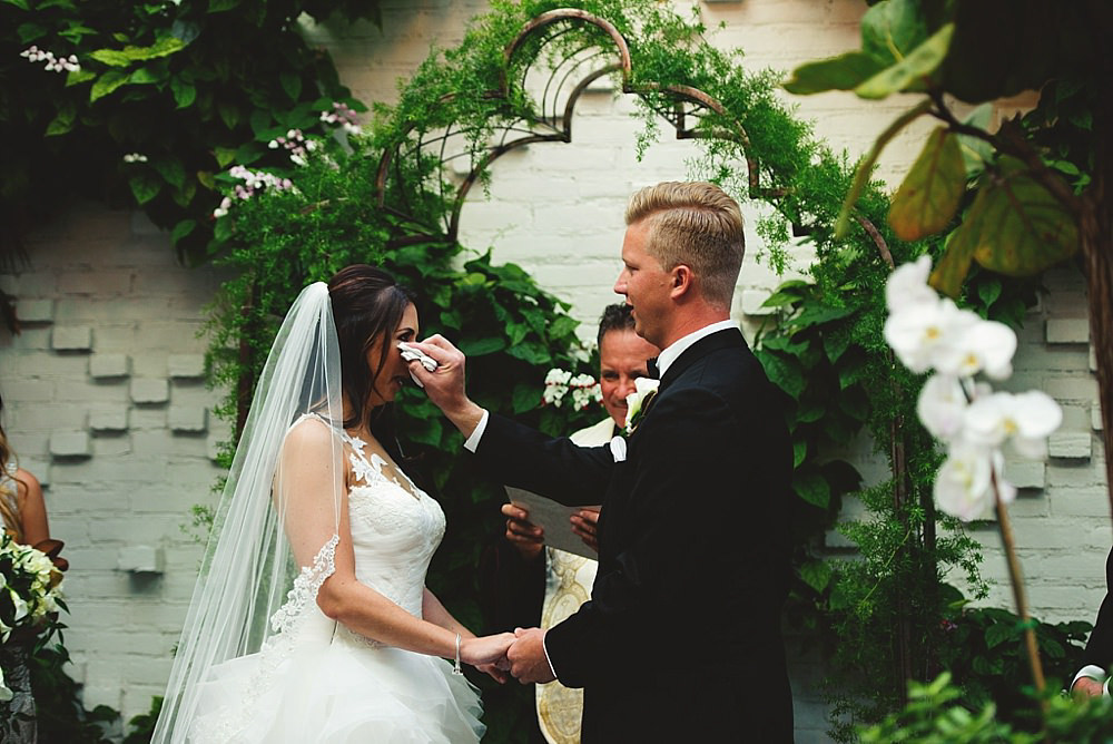 groom wiping a tear away