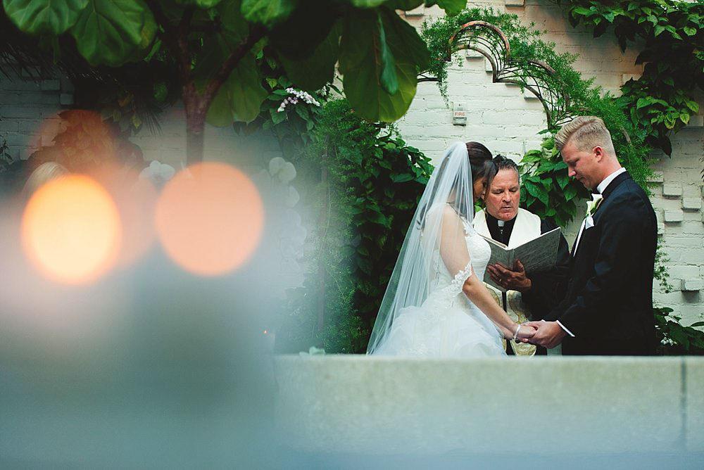 oxford exchange wedding : bride and groom praying