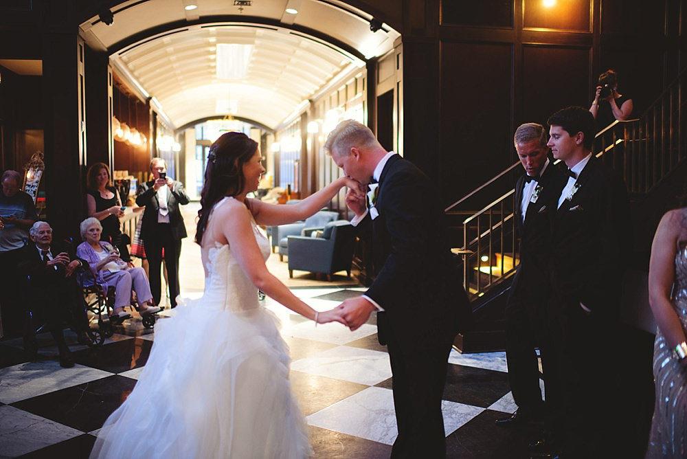 oxford exchange wedding : groom kissing brides hand