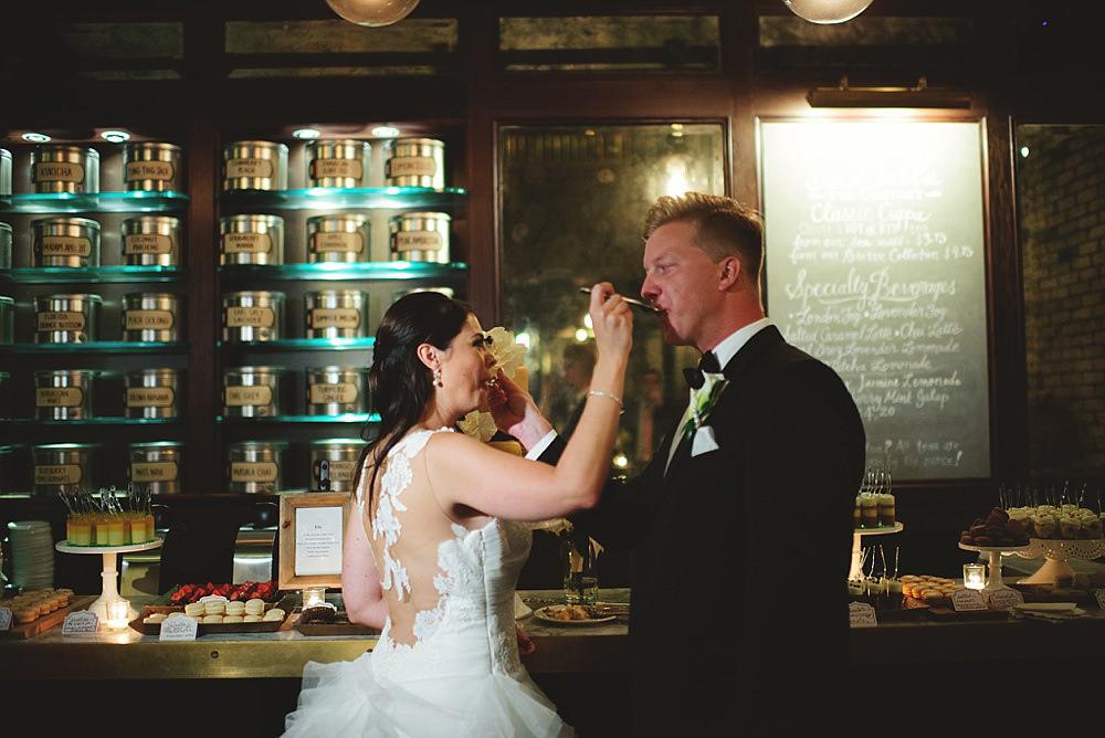 oxford exchange wedding : cake feeding