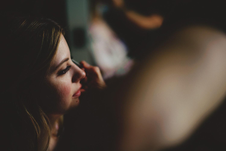 casa feliz wedding photos: bride getting makeup done