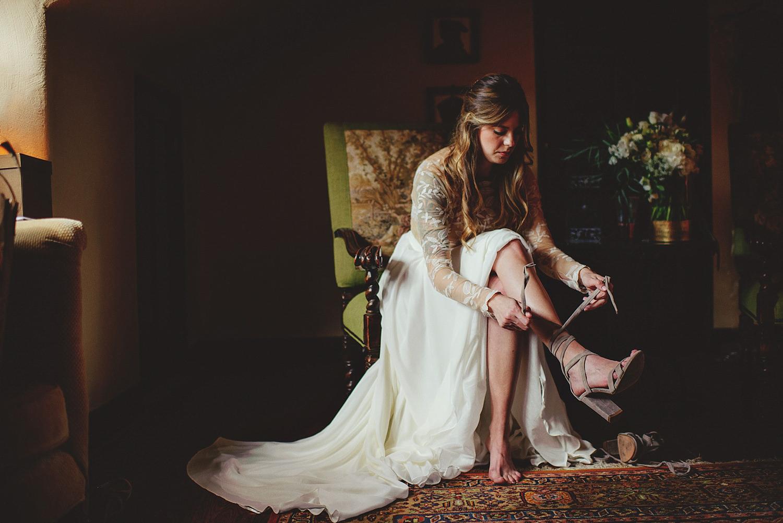 casa feliz wedding photos: bride tying shoes