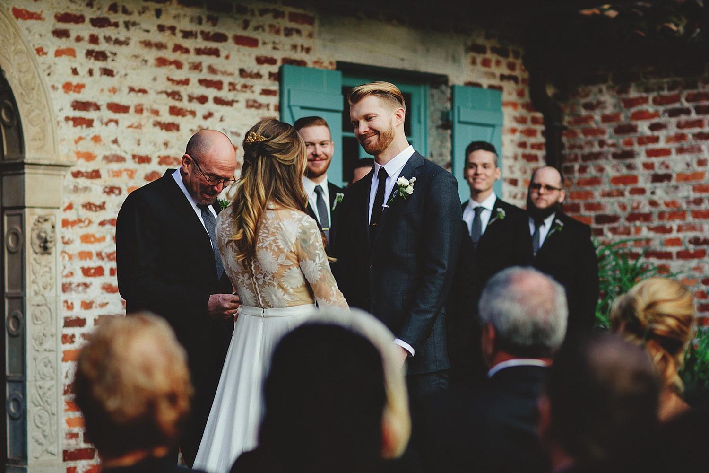 casa feliz wedding photos: groom smiling at bride