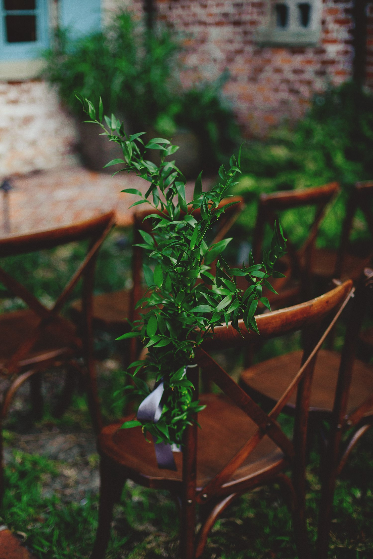 casa feliz wedding photos: greenery on chairs