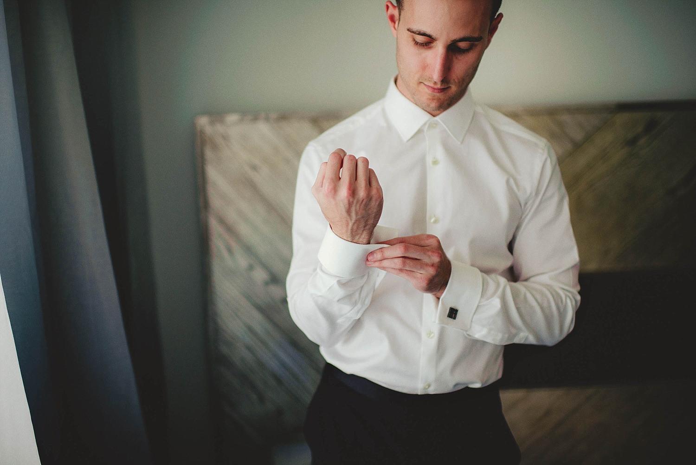 romantic-w-fort-lauderdale-wedding: groom buttoning cuff links