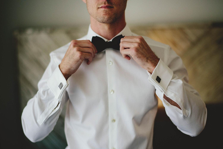 romantic-w-fort-lauderdale-wedding: groom straighting bow tie