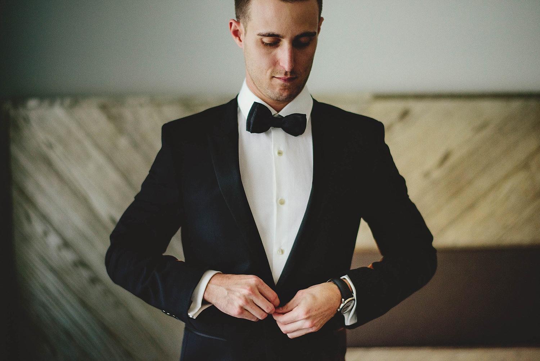 romantic-w-fort-lauderdale-wedding: groom buttoning jacket