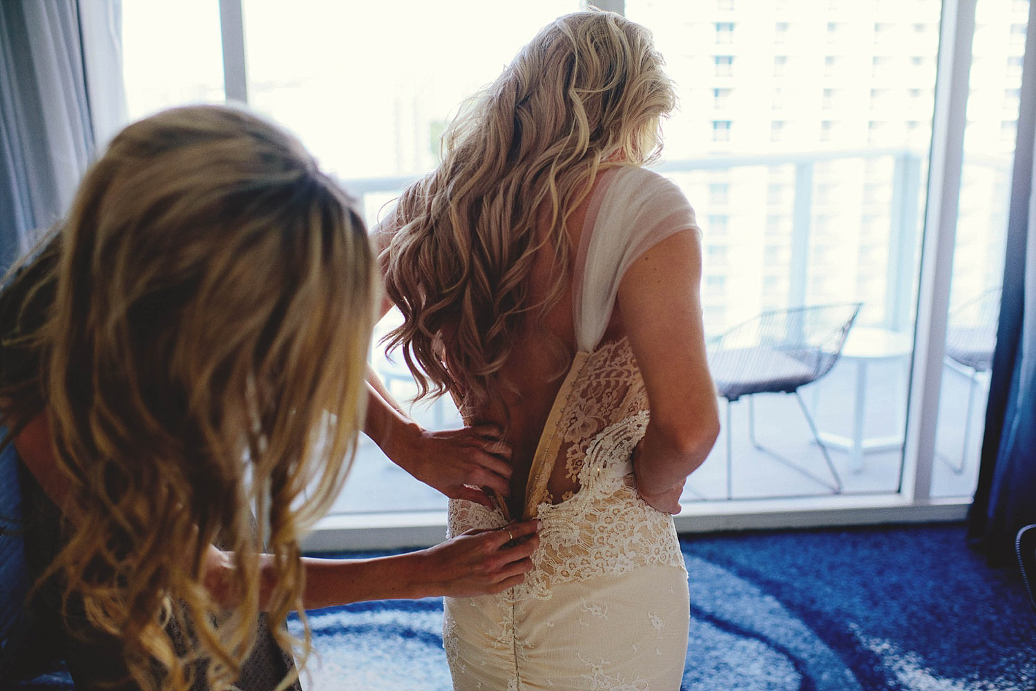 romantic-w-fort-lauderdale-wedding: maid of honor zipping up bac