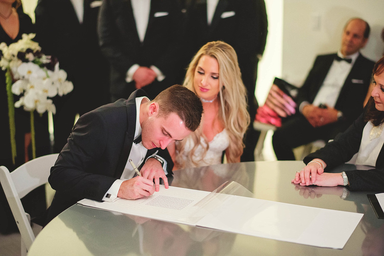 romantic-w-fort-lauderdale-wedding: signing the kutabah