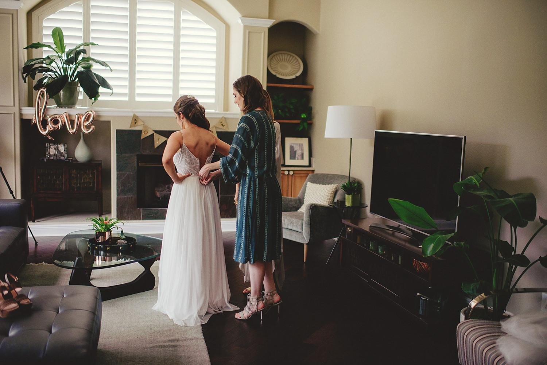 knowles memorial chapel wedding: bride putting on wedding dress