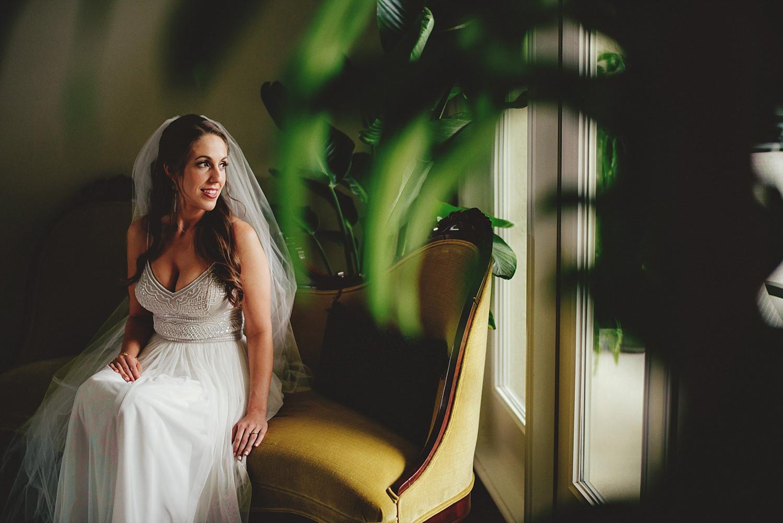 boho bhldn bride sitting in chair