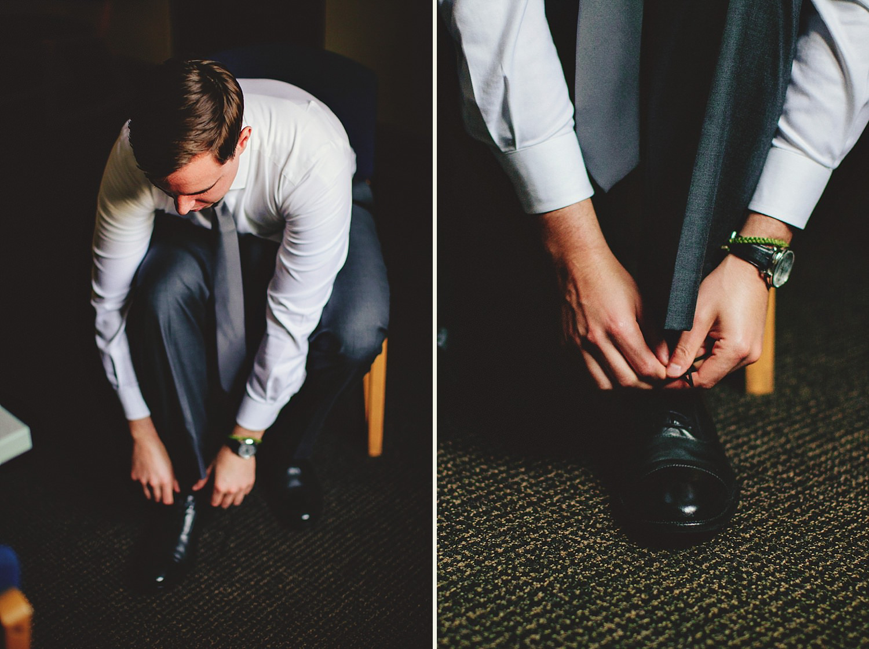 knowles memorial chapel wedding: groom putting on shoes