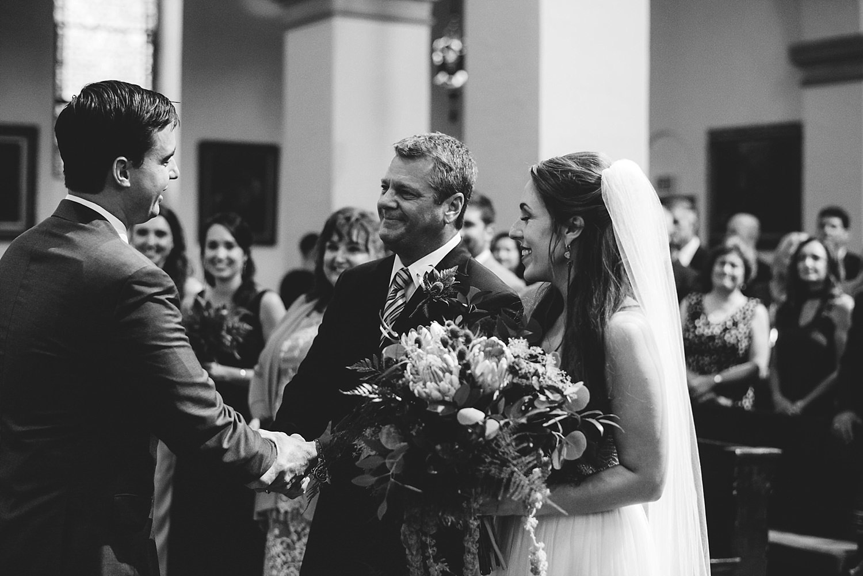 knowles memorial chapel wedding: father of bride shaking grooms