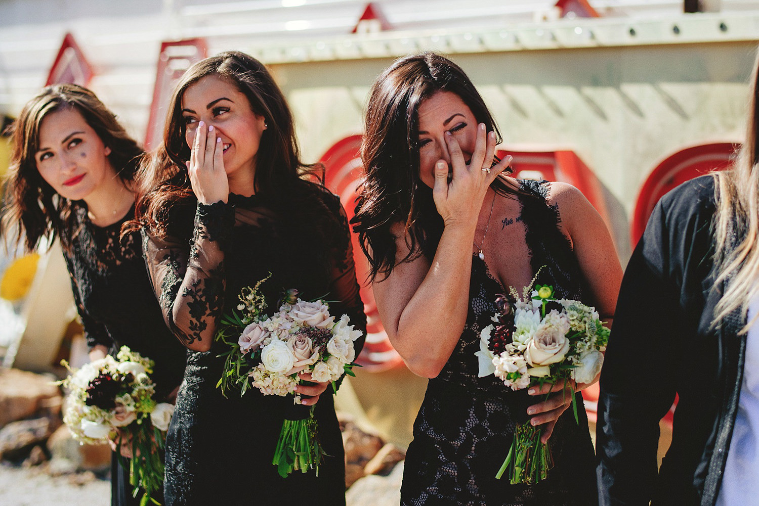neon museum wedding - bridesmaids crying