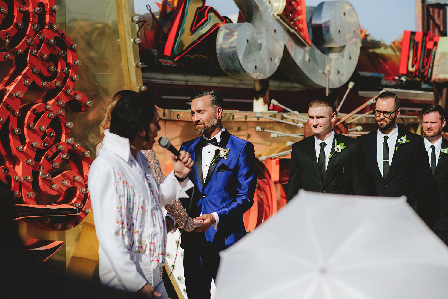 neon museum wedding - groom saying vows