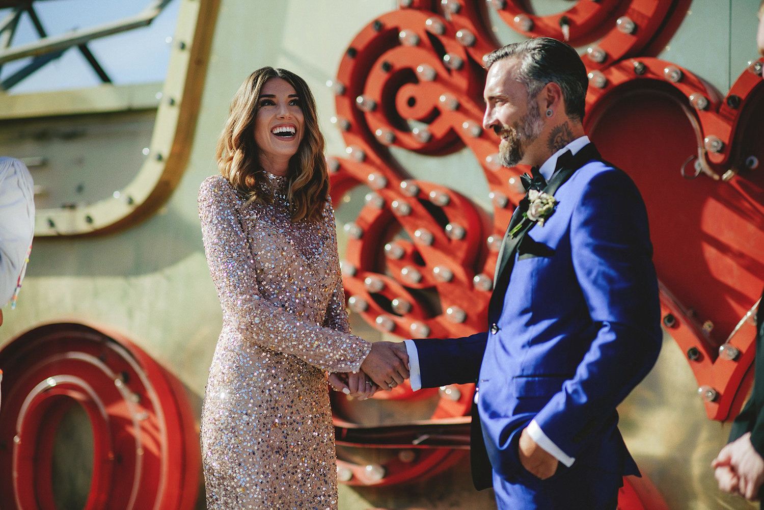 neon museum wedding - bride laughing