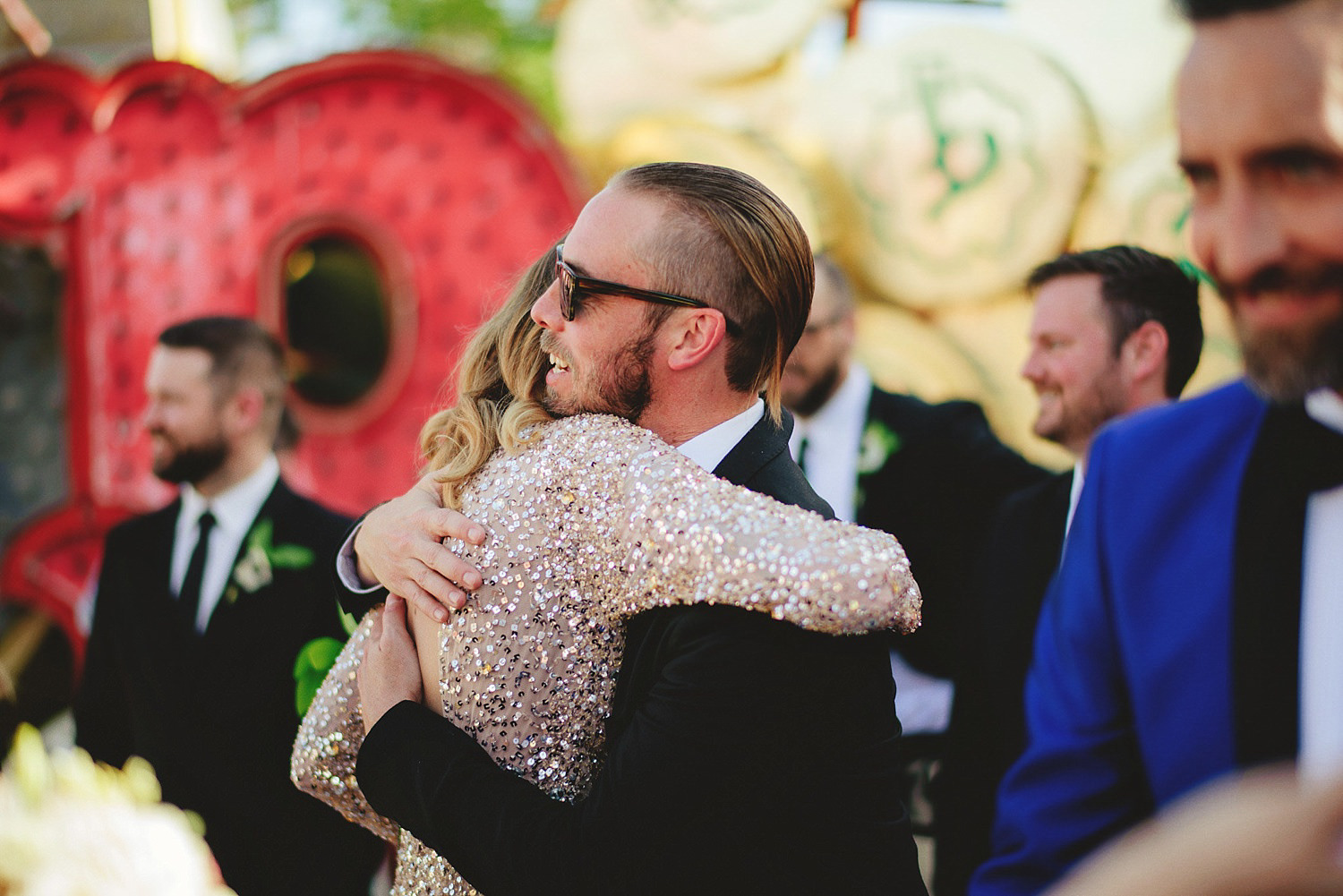 neon museum wedding - hugging after ceremony