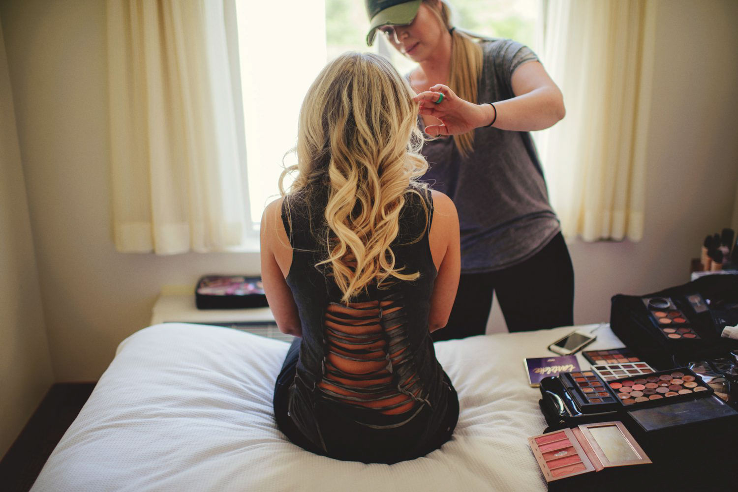 editorial ringling wedding: bride getting makeup done