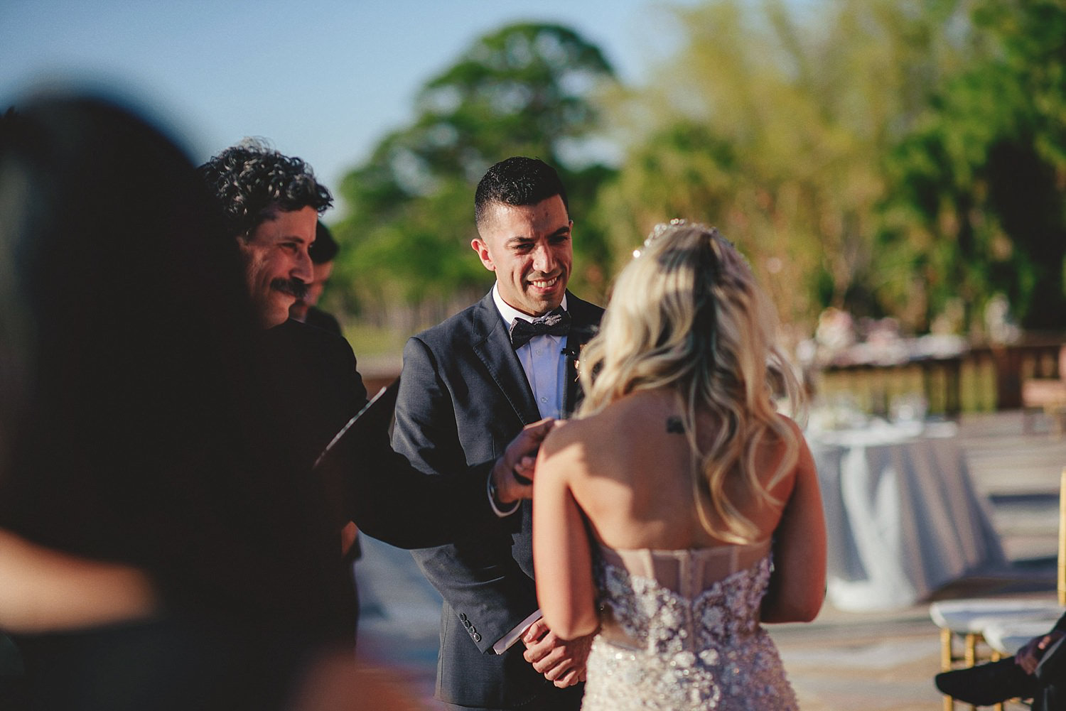 editorial ringling wedding: groom smiling at bride