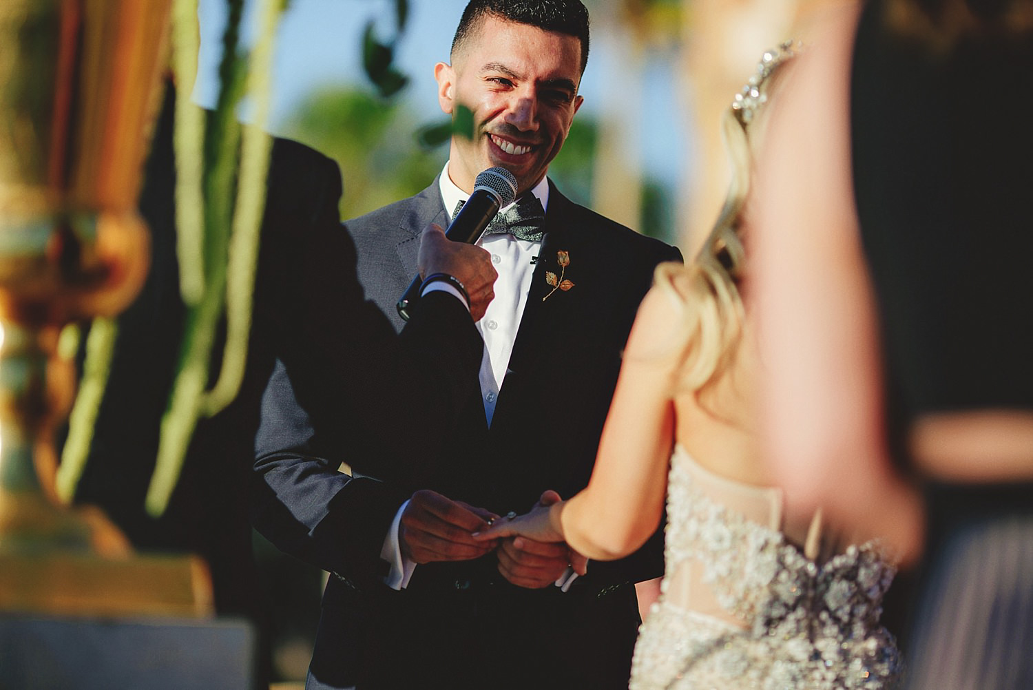 editorial ringling wedding: groom putting on brides ring