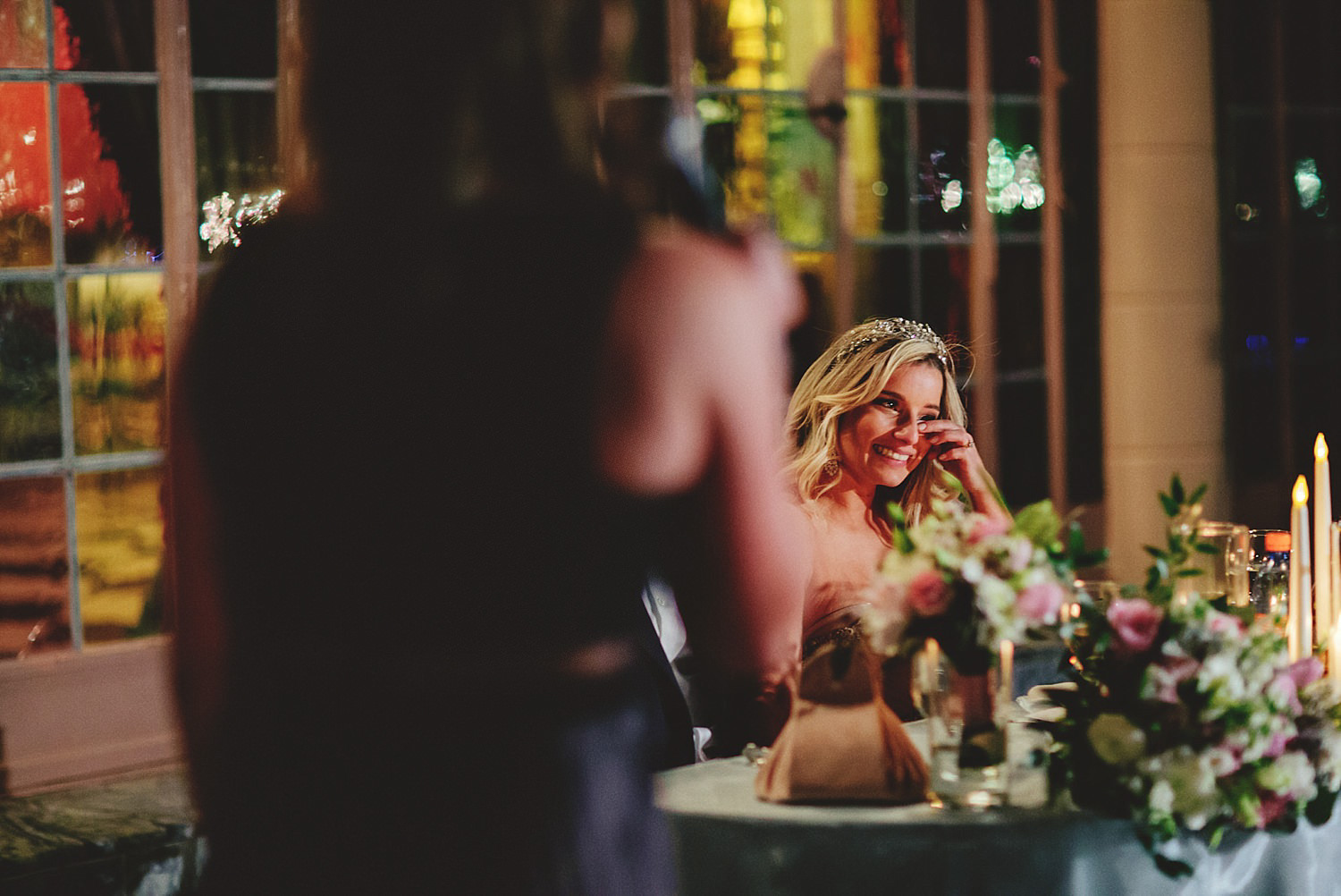 editorial ringling wedding: bride crying from maid of honor spee