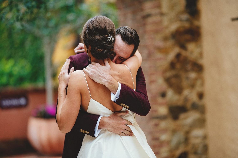 intimate bella collina wedding: bride and groom hugging