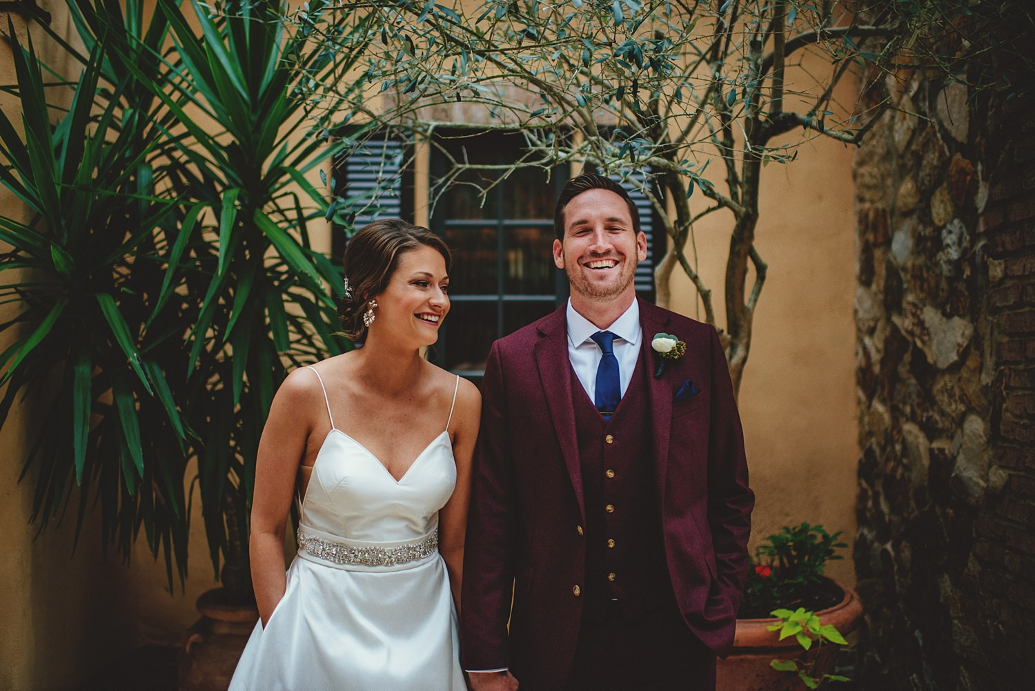 intimate bella collina wedding: bride and groom laughing