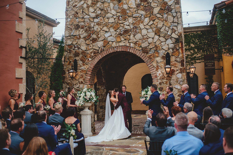 intimate bella collina wedding: first kiss