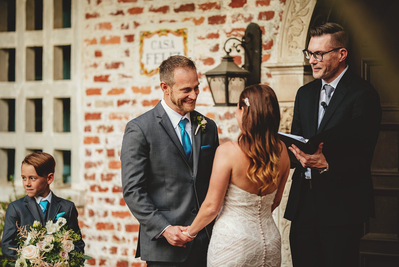 intimate casa feliz wedding: groom smiling