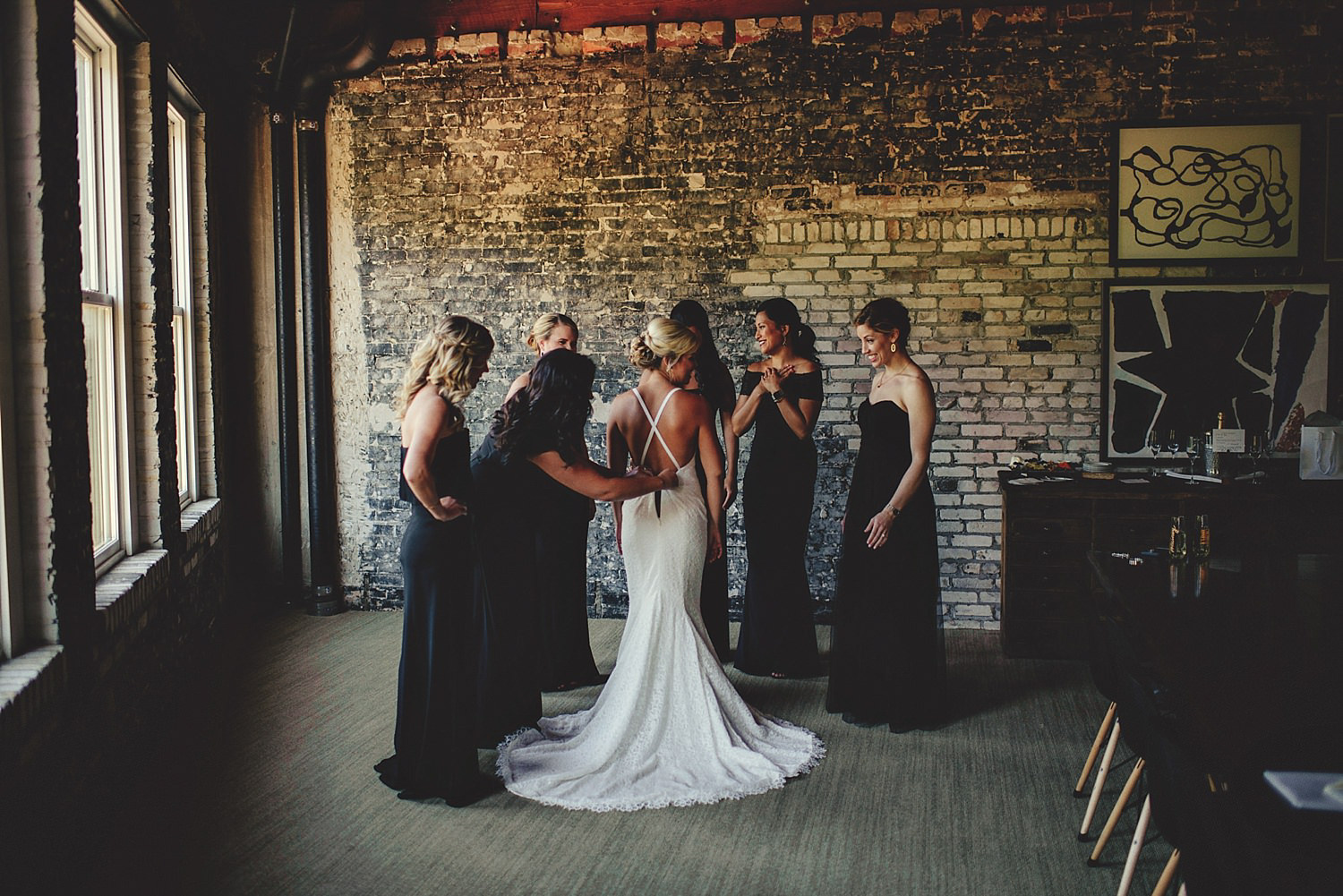 bride getting dressed in room at OE