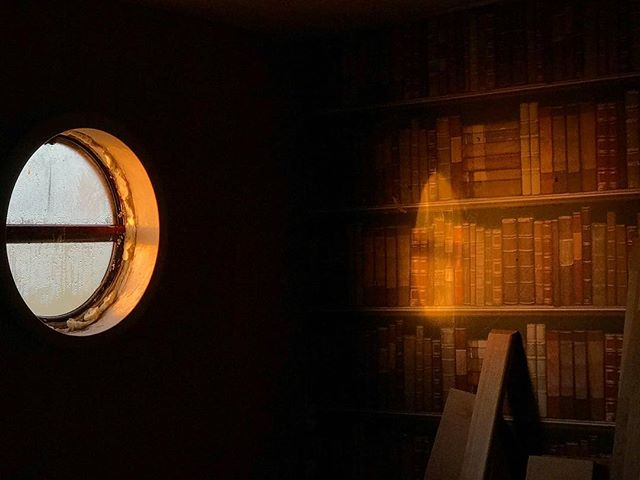 My unfinished window and bookshelf wallpaper. . . . #morning #light #sunrise #boat #dutchbarge #barge #porthole #book #books #window