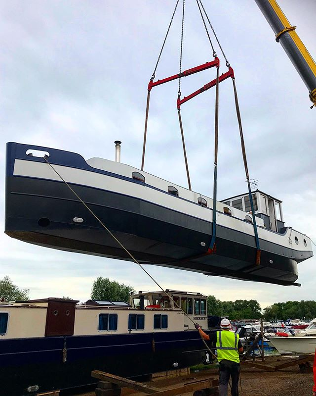 Our boat being put back in the water. . . . #boat #dutchbarge #crane #barge #river #canal #bedford #marina