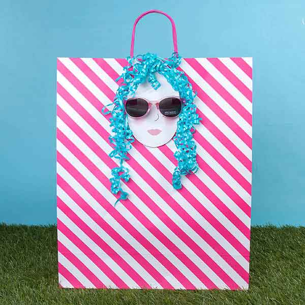 Download the free printable faces to make your sunglass gift more memorable!